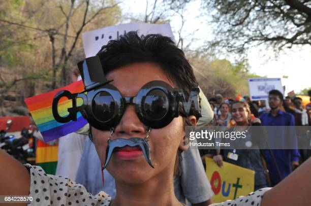 LGBT community member along with supporters taking part in central India`s first gay pride parade taken out to mark the International Day against...