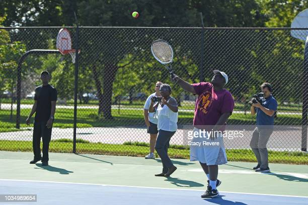 Community member Freddie Chapman hits the honorary first serve during the Laver Cup Legacy Court Ceremony at Garfield Park on September 17 2018 in...