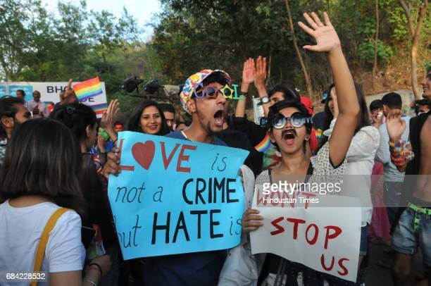 LGBT community members along with supporters taking part in central India`s first gay pride parade taken out to mark the International Day against...