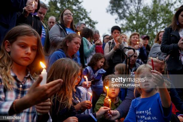 Community members and congregants attend a candlelight vigil for the victim of the Chabad of Poway Synagogue shooting on April 28, 2019 in Poway,...