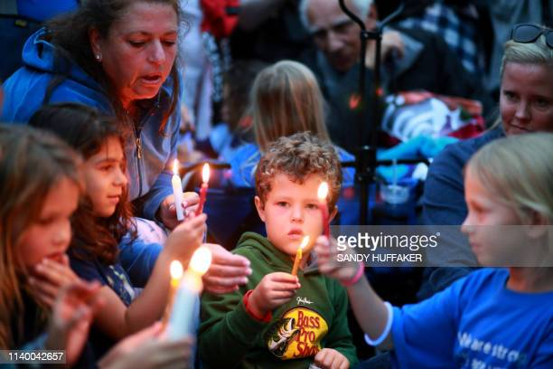 Community members and congregants attend a candlelight vigil for the victim of the Chabad of Poway Synagogue shooting at Valle Verde Park on April 28...