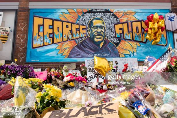 Community members gather on 38th and Chicago Avenue in Minneapolis, where George Floyd was killed, on June 4, 2020. The intersection has served as a...