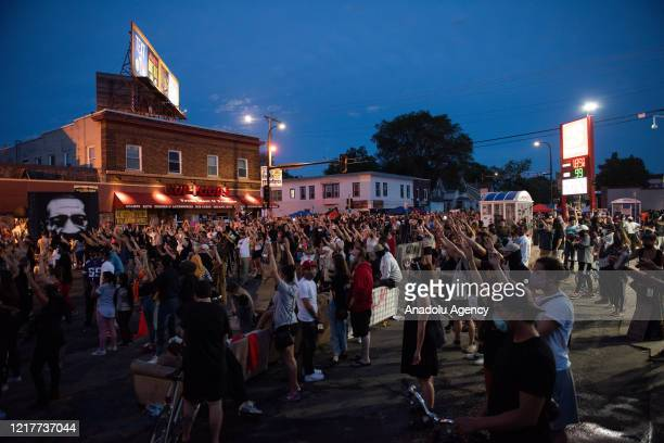 Community members gather on 38th and Chicago Avenue in Minneapolis where George Floyd was killed on June 4 2020 The intersection has served as a...