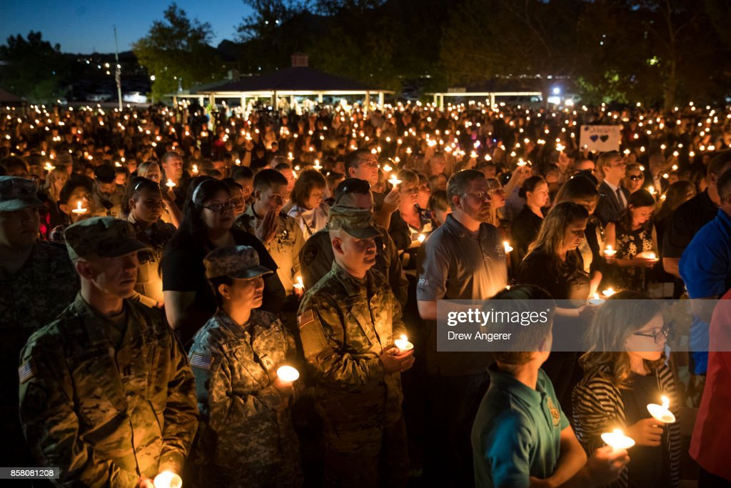 Community members hold candles as they attend a vigil for fallen Las Vegas Metropolitan Police Department Officer Charleston Hartfield at Police Memorial Park on October 5, 2017 in Las Vegas, Nevada. Hartfield, who was off duty at the Route 91 Harvest country music festival on October 1, was killed when Stephen Paddock opened fire on the crowd killing at least 58 people and injuring more than 450. The massacre is one of the deadliest mass shooting events in U.S. history.