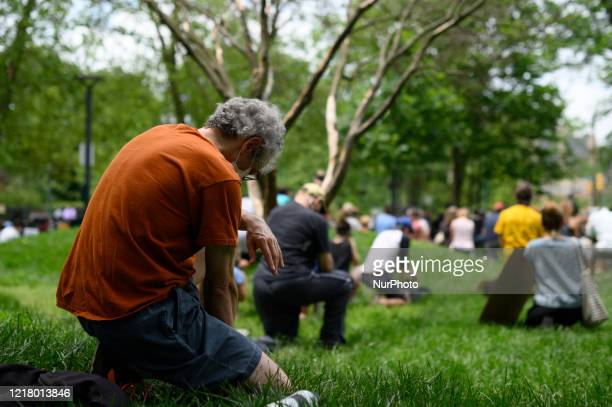 Community members kneel for 8 minutes and 46 seconds during a familyfriendly and peaceful protest in the diverse and liberal Mount Airy neighborhood...