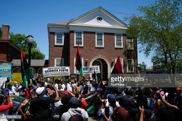 Community members stage a rally outside the Camden History Society during a Black Lives Matter protest march organized by Black Men Rising in Camden...