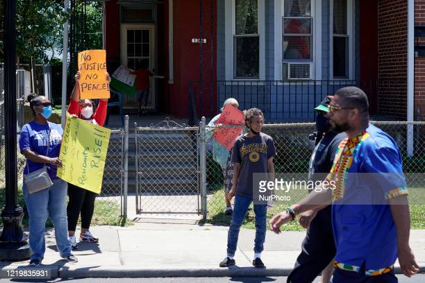 Community members take part in a Black Lives Matter protest organized by Black Men Rising in Camden NJ on June 13 2020