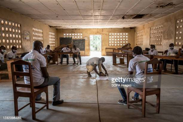 """Community mobiliser"""" prepares a picture to point out areas of the body that are likely to spread Ebola during a training led by the charity Goal..."""