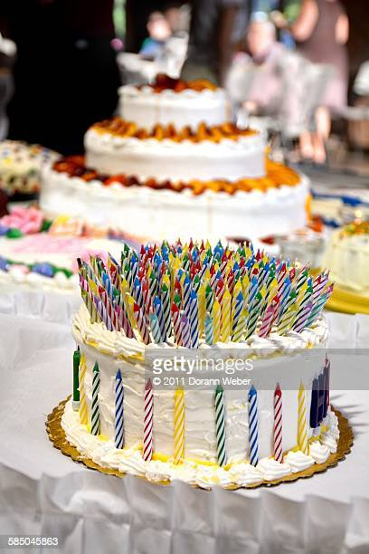 community  - birthday cake lots of candles stock photos and pictures