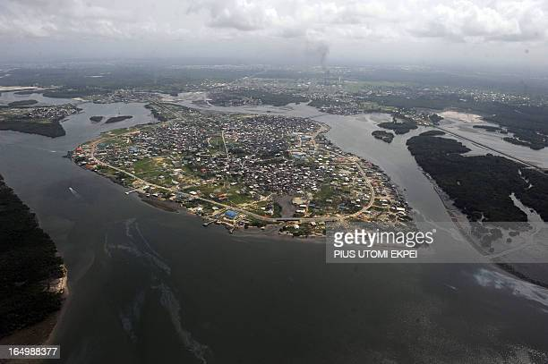 A community sandwiched by creeks devastated as a result of spills from oil thieves and Shell operational failures in Niger Delta on March 22 2013...