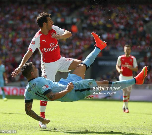 FA Community Shield 2014 Arsenal v Manchester City Wembley Stadium Manchester City's Aleksandar Kolarov and Arsenal's Ssanti Cazorla battle for the...