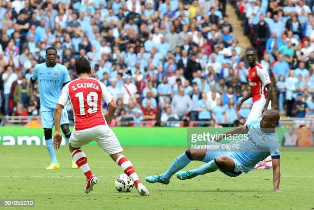 FA Community Shield 2014 Arsenal v Manchester City Wembley Stadium Manchester City's Fernando and Arsenal's Santi Cazorla battle for the ball