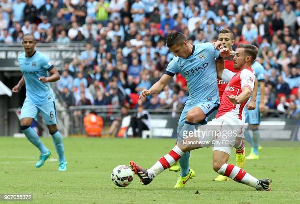 FA Community Shield 2014 Arsenal v Manchester City Wembley Stadium Manchester City's Stevan Jovetic and Arsenal's Aaron Ramsey battle for the ball