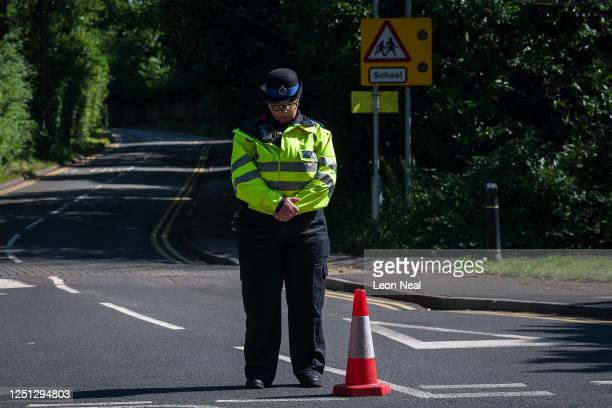 Community Support Officer bows her head during a minute silence for the murdered school teacher James Furlong as she stands on duty near The Holt...