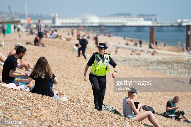 Community Support Officers patrol the beach on May 09 2020 in Brighton England Officers are asking people to observe lockdown rules and asking people...