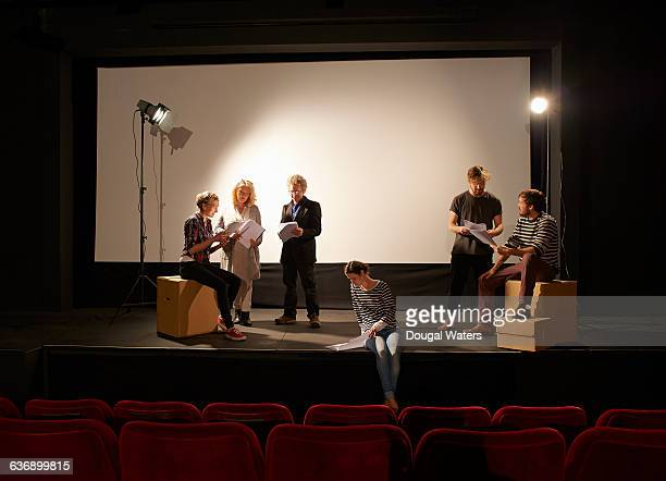 community theatre group learning script on stage. - rehearsal stock pictures, royalty-free photos & images