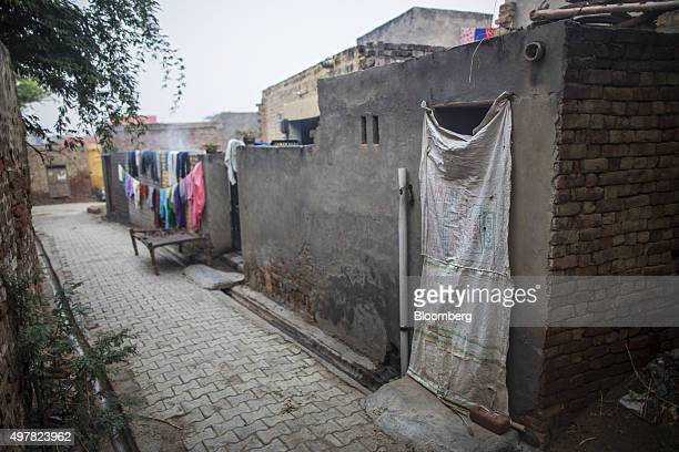 A community toilet right stands near the home of day laborer Kamlesh in Lahli village Haryana India on Tuesday Nov 3 2015 After years of volunteering...