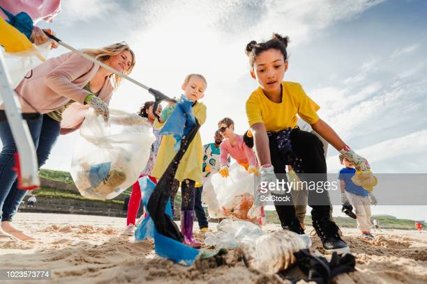 community volunteer groups on the beach - clean stock pictures, royalty-free photos & images
