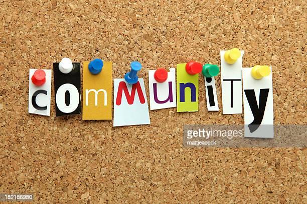 Community word pinned onto a corkboard