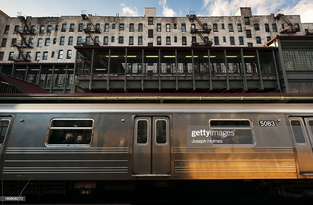 CONTENT] Communters gaze out the windows of the Q line subway train as it pauses in Brooklyn's Prospect Park station in December 2010.