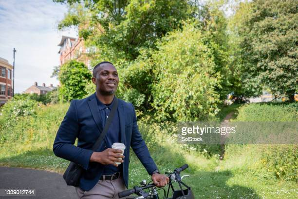commute & coffee - green blazer stock pictures, royalty-free photos & images