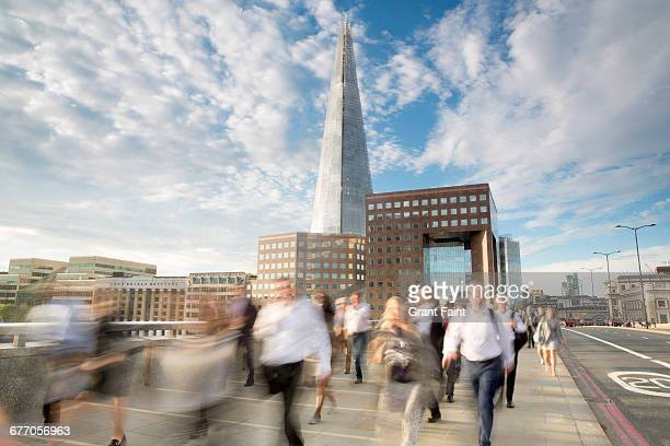commute. - london bridge stock pictures, royalty-free photos & images
