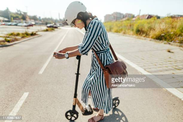 commute to work by electric scooter - work helmet stock pictures, royalty-free photos & images