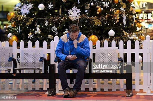 A commuter at Glasgow Queen Street Station waits for his train as the rail disruption continues on December 5 2013 in Glasgow Scotland Parts of the...