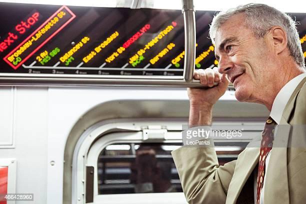 Commuter businessman indide subway train