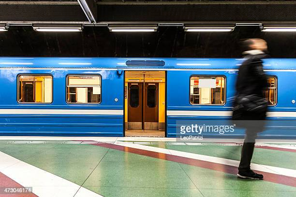 commuter businessman walking on the subway platform - railroad car stock pictures, royalty-free photos & images