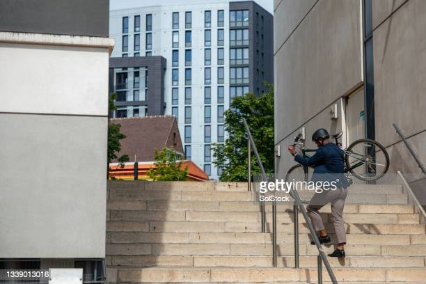commuter carrying his bicycle - green blazer stock pictures, royalty-free photos & images