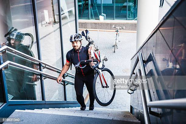 Commuter climbing stairs outside the office