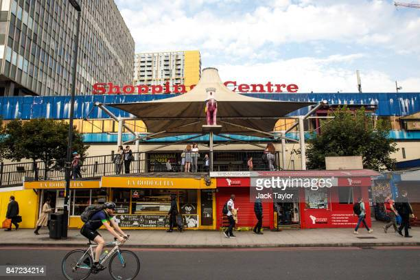 A commuter cycles past the Elephant and Castle shopping centre on August 22 2017 in London England Over the last decade the landscape of South London...