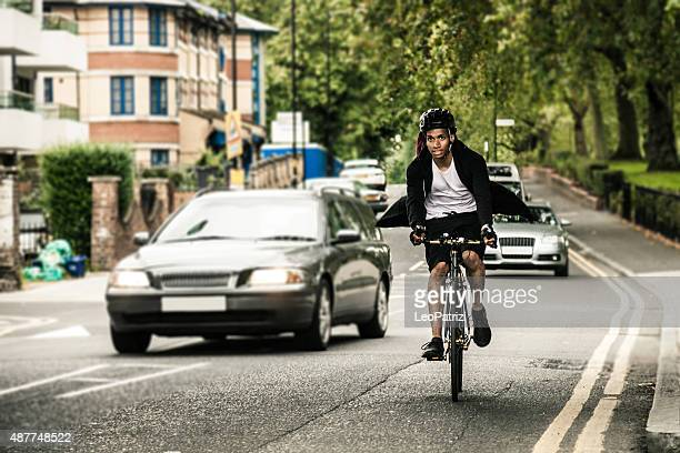 commuter cycling in hackney london going at work - cycling stock pictures, royalty-free photos & images