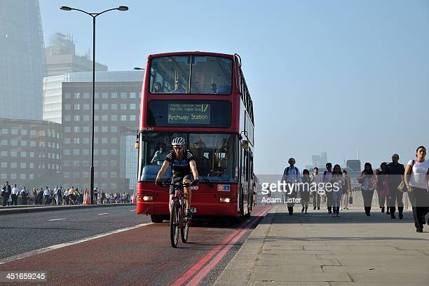 A man cycles his bike at Rush Hour in London down the Bus Lane A bus is looming down on him Discussion of cycling safety and the Cycling...