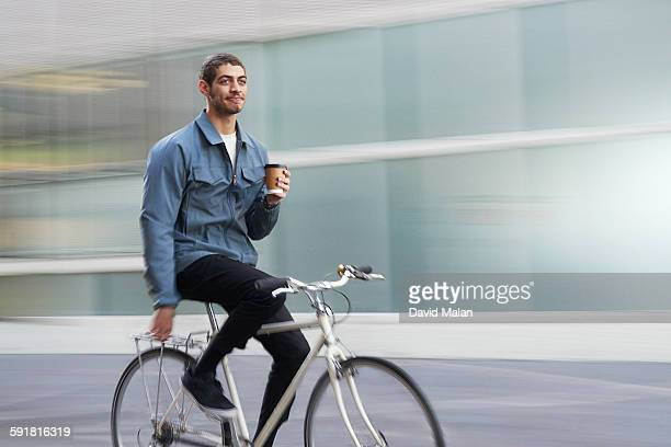 commuter cyclist with coffee (soft background)