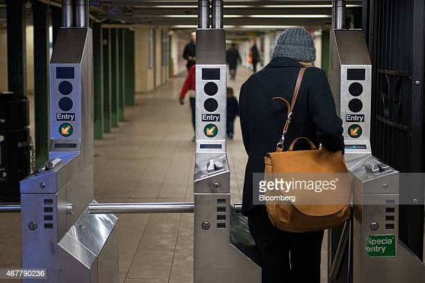A commuter enters the 14th StreetUnion Square subway station in New York US on Thursday March 26 2015 It now costs $275 to ride the New York subway...