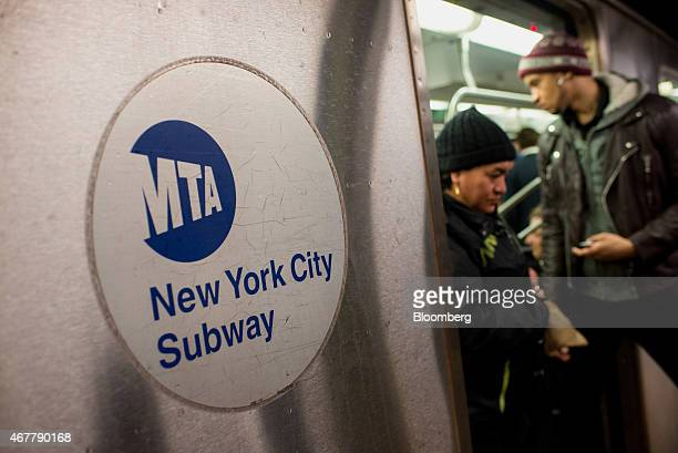 A commuter exits a 5 train at the 14th StreetUnion Square subway station in New York US on Thursday March 26 2015 It now costs $275 to ride the New...