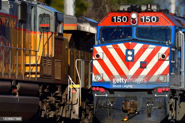 commuter, freight train meet - geneva illinois stock pictures, royalty-free photos & images