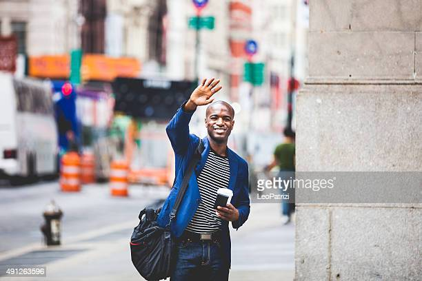 commuter going at work in new york - waving gesture stock photos and pictures