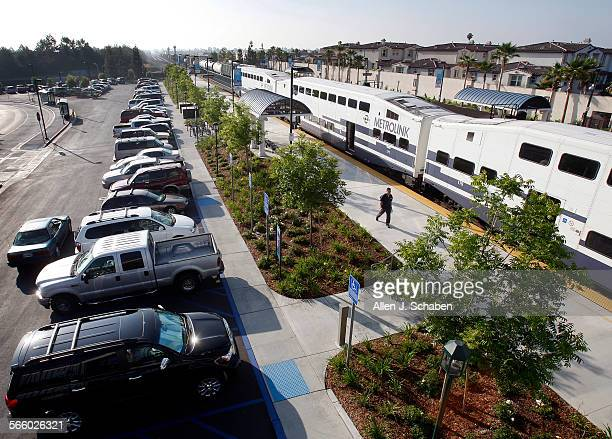 A commuter heads to the train in Buena Park at the newest Metrolink station which is barely nine months old and already it's exceeded parking...