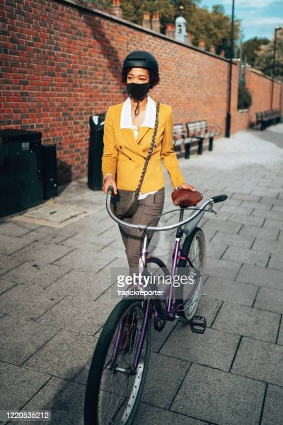 commuter in uk with face mask - riding stock pictures, royalty-free photos & images