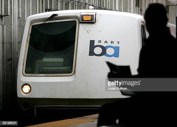 A commuter looks on as a Bay Area Rapid Transit train pulls into a station July 5 2005 in San Francisco California With a strike deadline looming at...