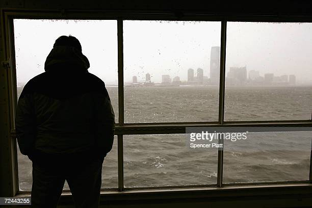 A commuter looks out of a window onboard a Staten Island ferry March 8 2005 in New York City The National Transportation Safety Board in a report...