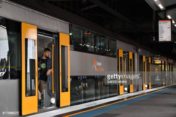 A commuter looks out the train doors at Circular Quay station in Sydney on February 13 2018 Australia's central bank on February 6 kept interest...
