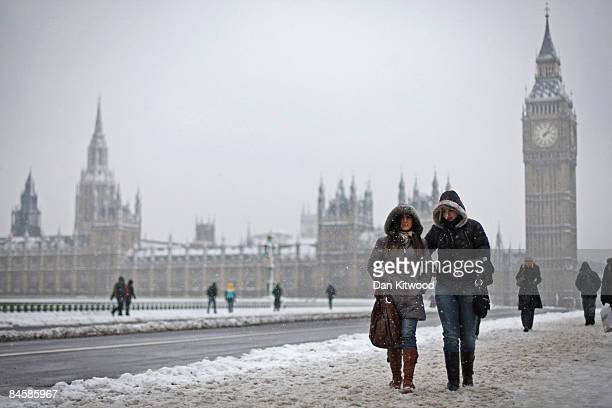 Commuter make their way across Westminster Bridge as the heavy snow that fell overnight starts to melt on February 2 2009 in London England Heavy...