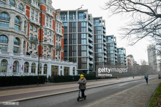 Commuter on an electric scooter passes One Hyde Park, a luxury residential and retail complex, in Knightsbridge, London, U.K., on Thursday, Jan. 7,...