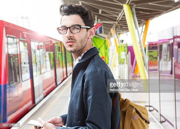 commuter on platform waiting for public transport - railway station stock pictures, royalty-free photos & images