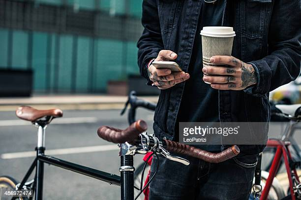 commuter parking his bicycle outside the office - fashionable stock pictures, royalty-free photos & images