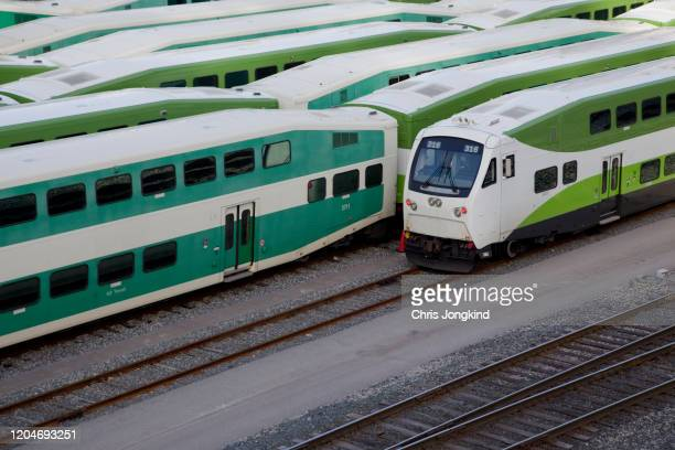 commuter passenger trains lined up in a rail yard - travel stock pictures, royalty-free photos & images